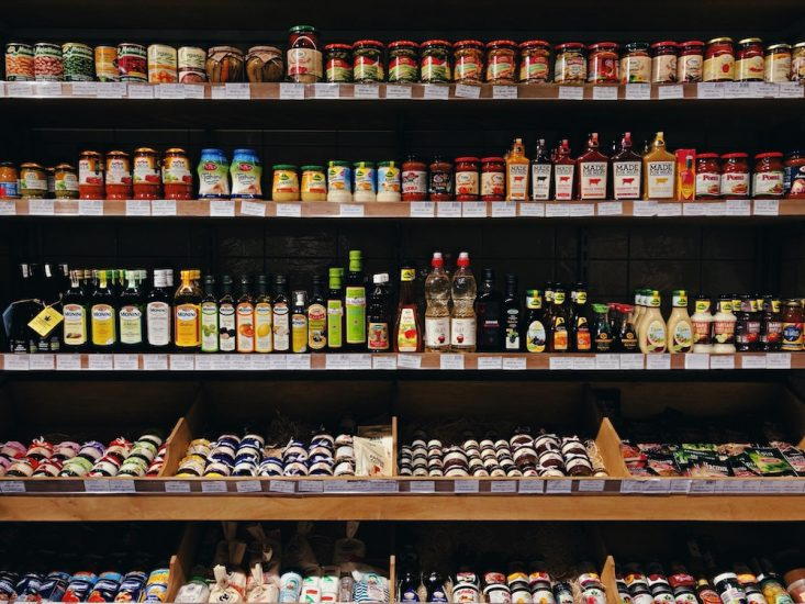 a supermarket aisle with dressings and condiments