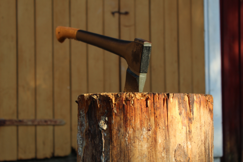Axe lodged in chunk of wood