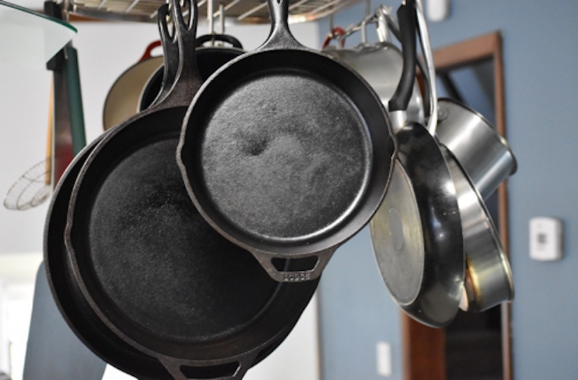 An array of cast iron skillets